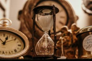 Photo of hourglass and clock to illustrate the passing ot time for the rewind technique
